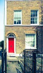 Vintage retro old effect old East London terrace home red door