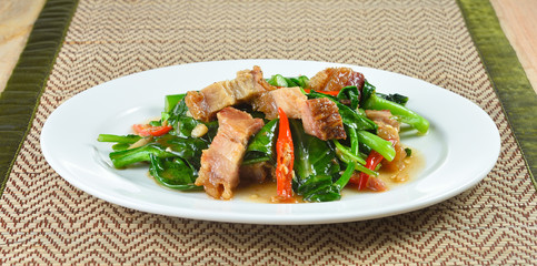 fried chinese broccoli   with crispy pork
