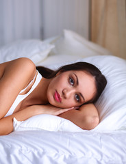 Pretty woman lying  in bed