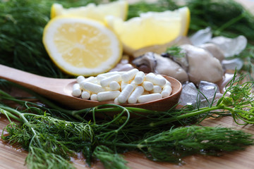 The zinc supplementary white capsule with fresh oyster