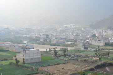 The mountain town of Zunil covered with fog