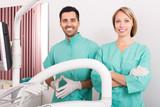 Happy dentist and head nurse