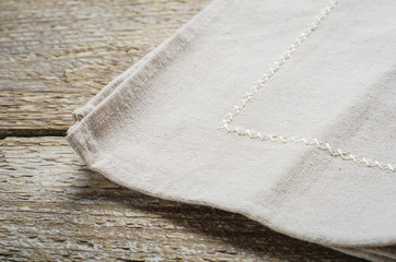 natural beige cotton cloth on wooden table