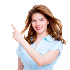 Happy woman shows a finger in the side.