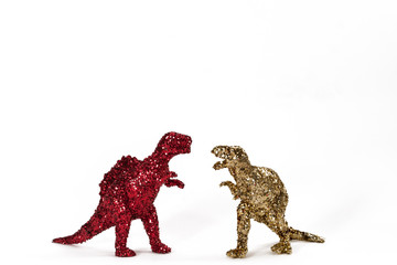 Dinosaurs in red and gold glitter on white. Landscape.