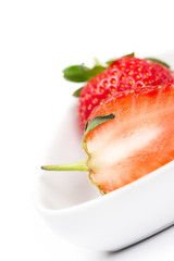 Closeup of a halved fresh ripe strawberry
