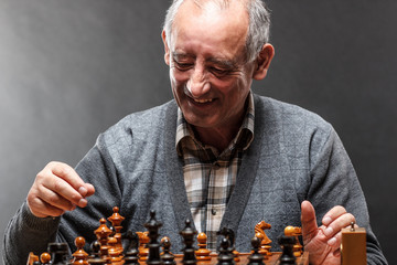 Senior man playing chess
