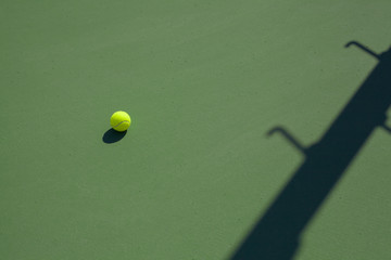tennis ball on hard court with copy space