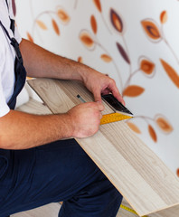 Marking the laminate with pencil and measuring tools