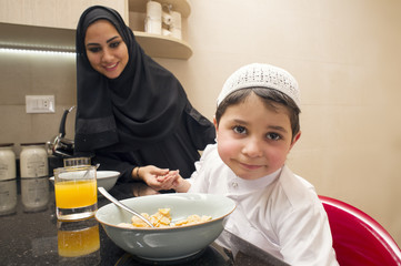 Arabian family of mom and son having breakfast