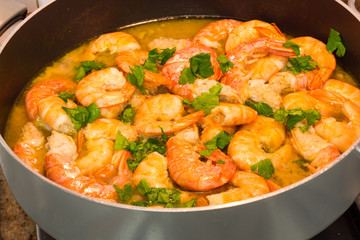 Shrimp cooking with parsley