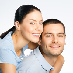 Portrait of cheerful smiling amorous young couple