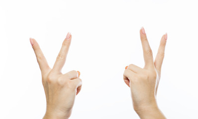 Female hands shows victory