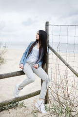 Young girl on the Baltic sea beach