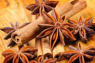 cinnamon and anise on the wooden background