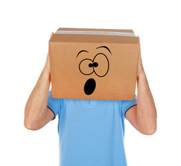 Man with cardboard box on his head and frightened emoticon face