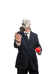 Businessman with gas mask  that is juggling with a red balls