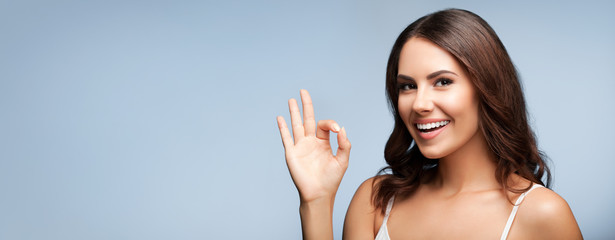 Woman showing okay gesture, with copyspace