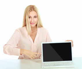 Attractive business girl showing laptop screen, isolated on