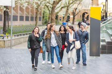 Group of friends walking and having fun together in London
