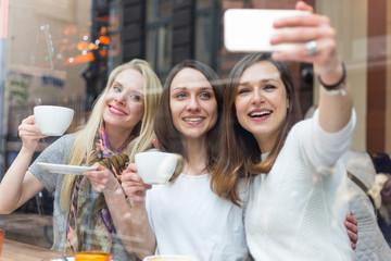 Women taking a selfie in a cafe in Copenhagen