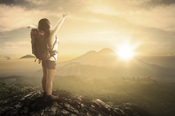 Backpacker enjoying freedom on mountain