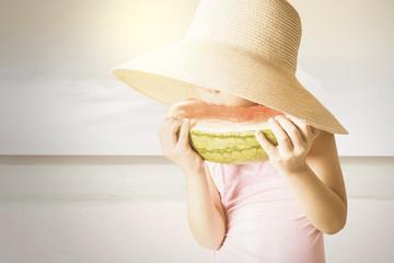 Closeup of child enjoy a watermelon