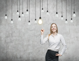 woman is pointing out the light bulbs. strategy.