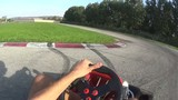 man drives go kart slow motion drifting  in the middle of curve