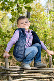 Boy Leaning on Arms on Top of Wooden Fence