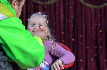 Girl Having Face Painted
