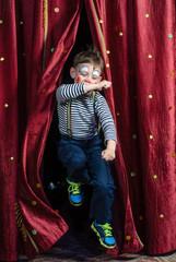 Boy Clown Jumping Through Stage Curtains