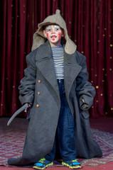 Boy Wearing Over Sized Coat Wearing Clown Make Up