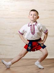 Little boy practicing a ballet pose