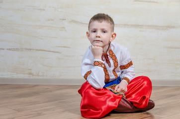 Inquiring boy with traditional folk costume
