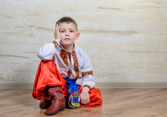 Inquiring boy with traditional folk costume
