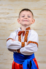 Happy child proud to wear the Ukrainian costume