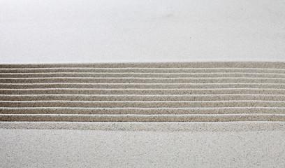 lignes horizontales dans le sable fin