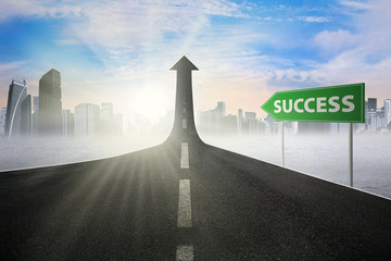 Signpost to success on the street upward