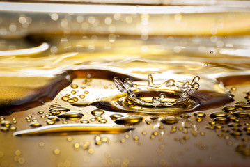Water drops in detail on gold plate