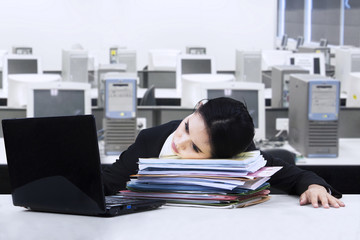 Tired businesswoman take a rest on documents 1