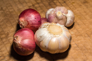 onion and garlic is spice of thai food on vintage background