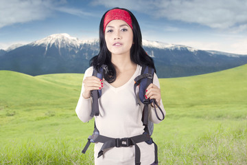 Young backpacker standing outdoors