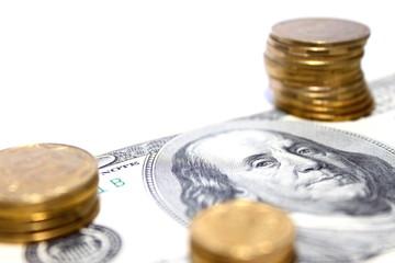 Coins on dollar bills.