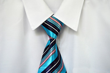White shirt and striped tie