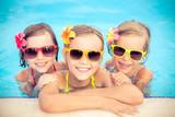 Fototapety Happy children in the swimming pool