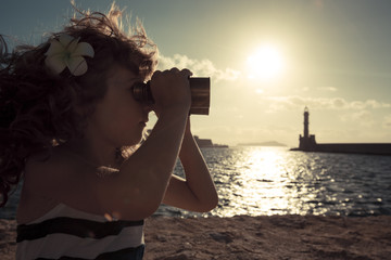 Sailor kid looking through the binoculars