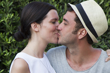Young couple on holidays, kising each other