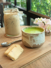 Matcha Green Tea and cookie on wooden tray