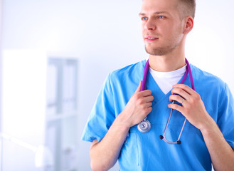 Doctor with stethoscope standing , crossed arms, isolated on